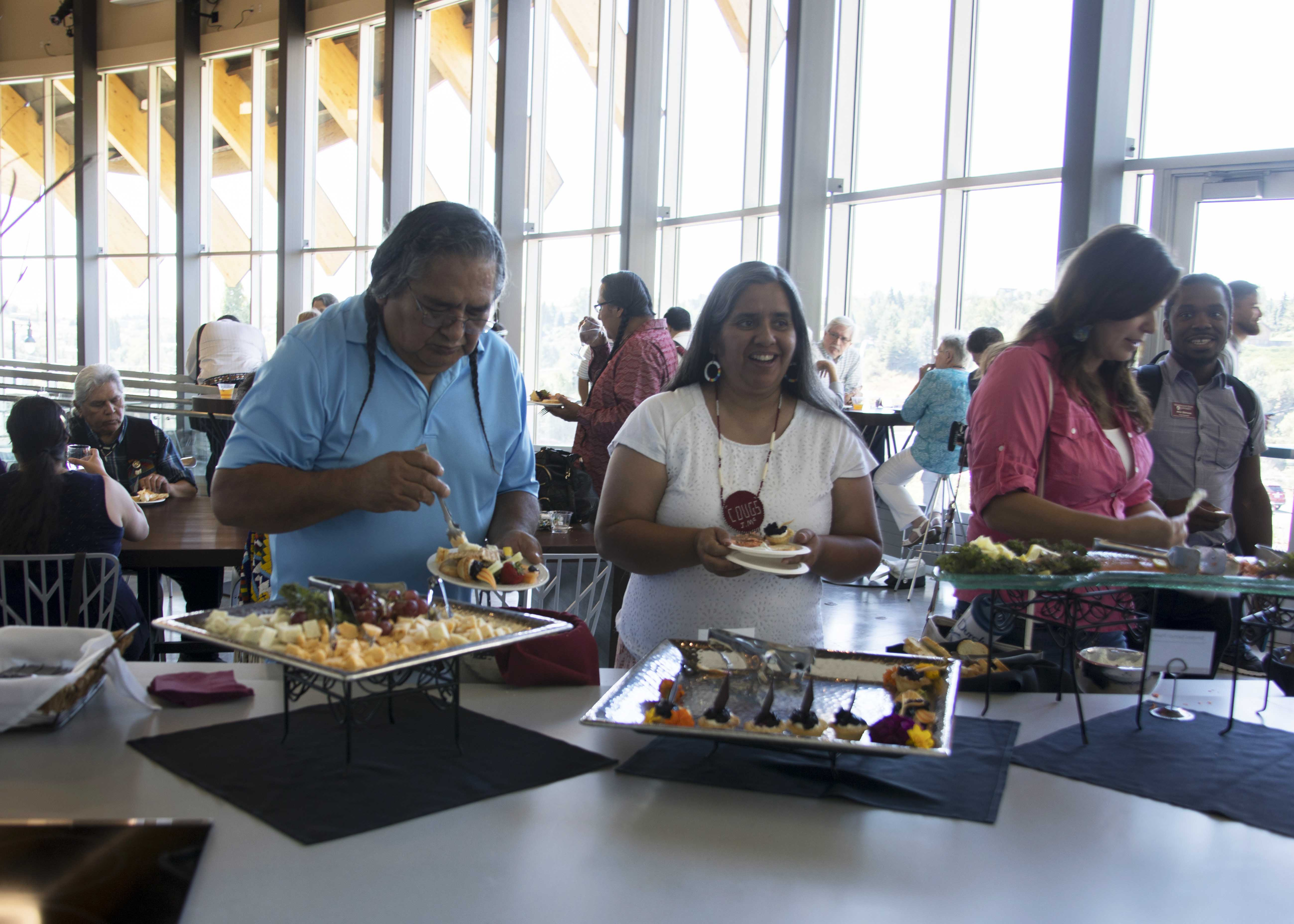 Guests enjoying light refreshments in the Cultural Center kitchen area.