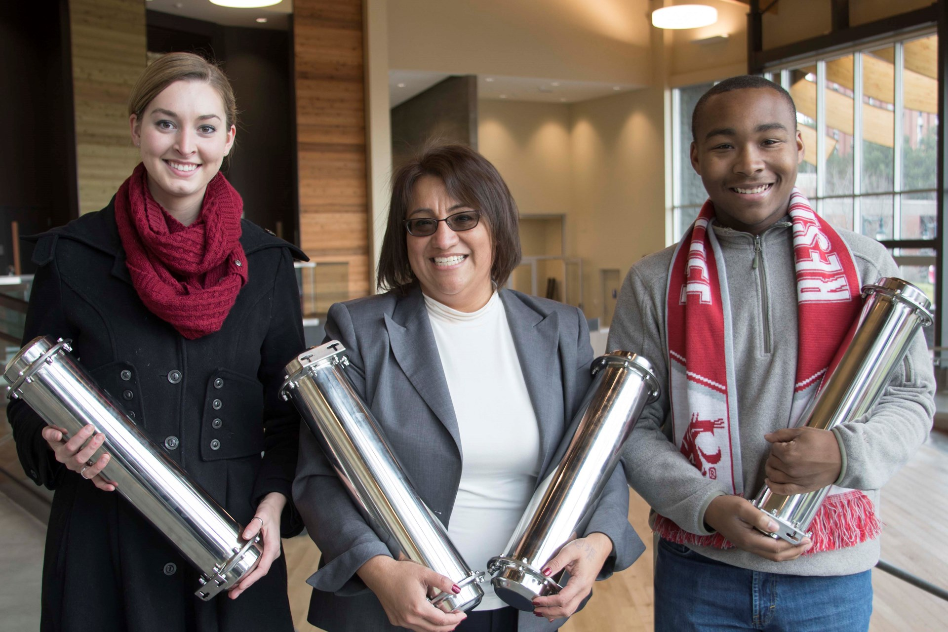 Mary Jo, student regent and ASWSU president holding time capsules